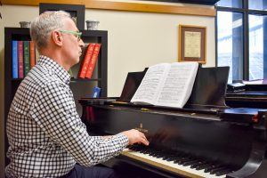 Professor Ronis plays a piano