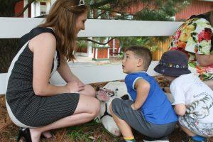 Allie Breunig talking to a young boy as an ambassador