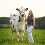 Image of Allie Breunig with one of her cows