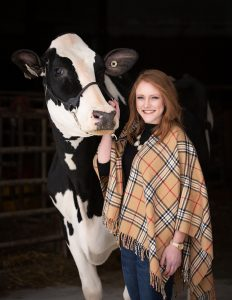 Allie Breunig with one of her cows