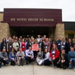 The 2019 Wisconsin Idea Seminar cohort stands with De Soto High School teachers and administration following a tour and a panel discussion with students.