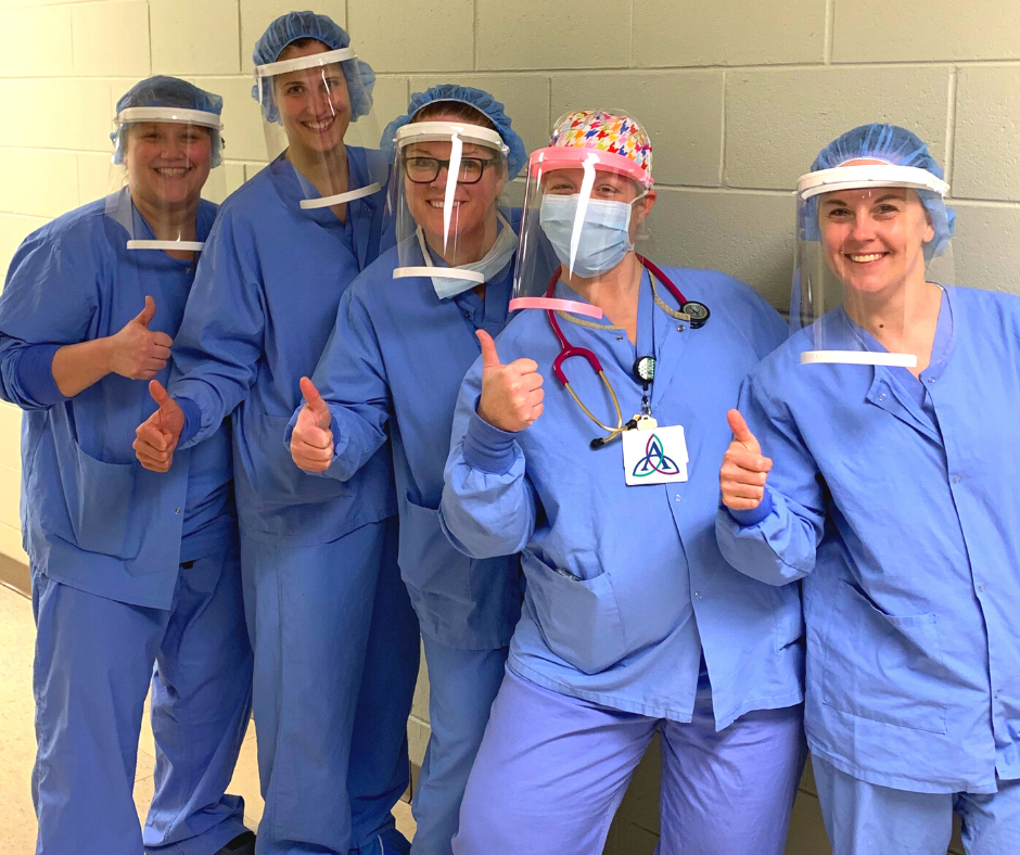 Portage County's IDEA Center, which the Wisconsin Idea Seminar visited in 2019, has been converted into an around-the-clock 3D printing facility to produce personal protective equipment for healthcare organizations. Here, nurses pose wearing the face shields that the IDEA Center produced.