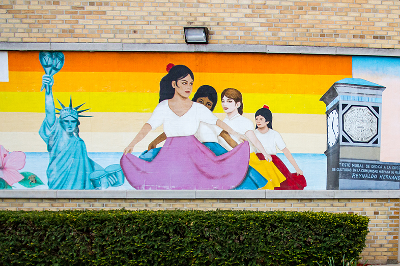 A mural at the United Community Center by prolific Milwaukee painter Reynaldo Hernández gestures to the layered identities in Milwaukee's Latino communities. The Wisconsin Idea Seminar visited the United Community Center in 2016 and 2018. (Photo by Catherine Reiland/UW-Madison)